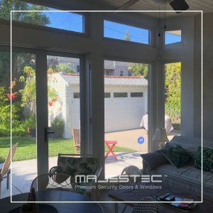 Living room with security screen doors and windows - Majestec, Redondo Beach, CA